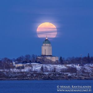 Full moon rising over Suomenlinna church, Hernesaari, Helsinki, Finland